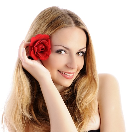 Beautiful girl with red rose in her hair photo
