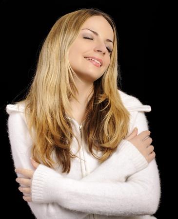 Girl enjoying softness of her sweater