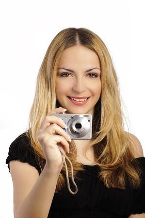 Girl taking a photo with a digital point-and-shoot camera