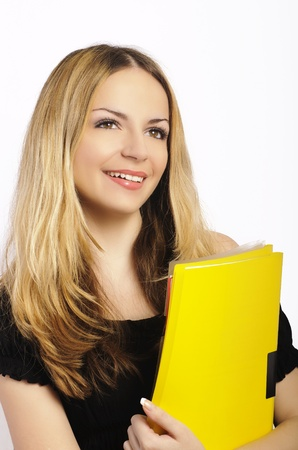 Attractive female student holding yellow files Stock Photo