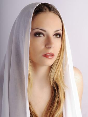 veiled: Angelic girl Stock Photo