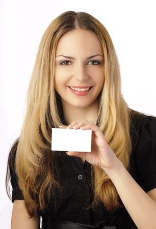 Pretty girl holding a blank business card photo