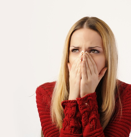 hand covering eye: Sad and shocked girl looking at something