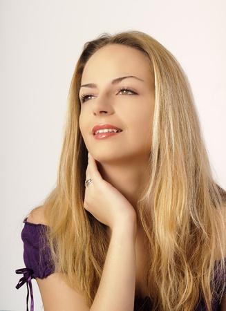 Beautiful, feminine blond young woman Stock Photo