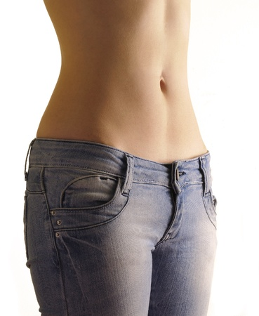 Sexy flat belly of a woman Stock Photo