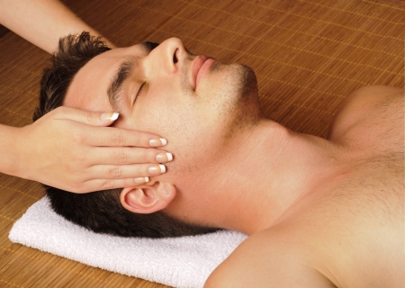 massage face: Man getting a face massage