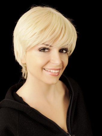 Beautiful young woman with short blond hair Stock Photo