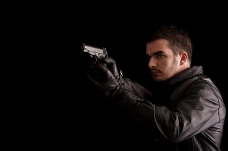 Young man holding a gun photo
