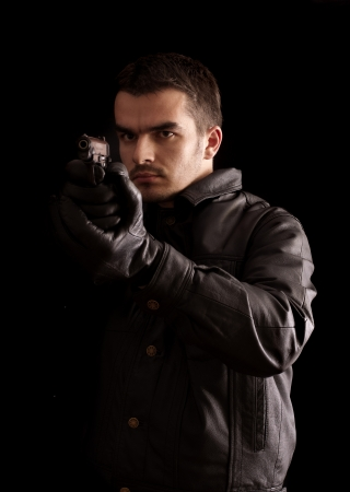 Young man holding a gun Stock Photo