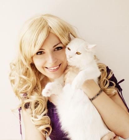Girl holding Persian cat