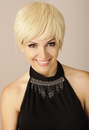 Pretty girl with short blond hair photo