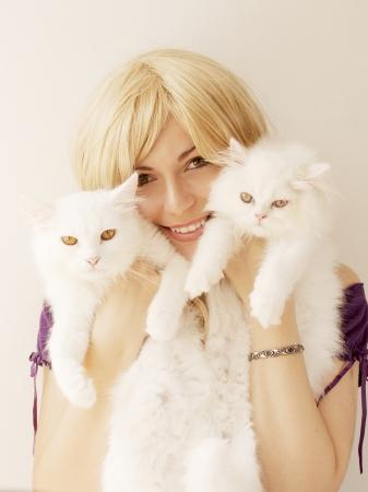 Girl holding Persian cats Stock Photo