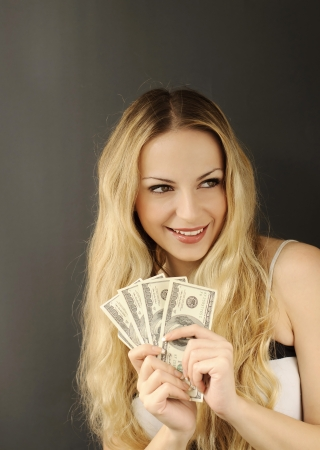 Girl holding 500 dollars