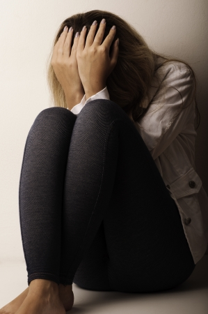 raped: Depressed young woman Stock Photo