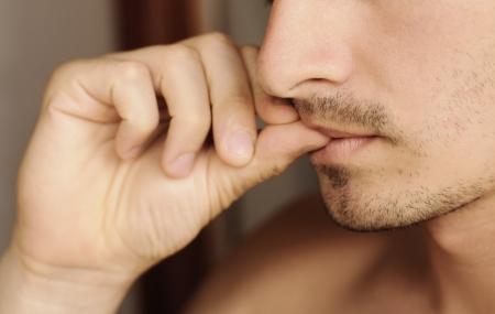 Man biting nails