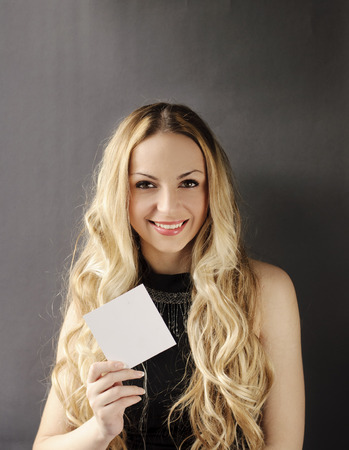 Girl holding blank piece of paper