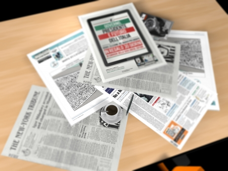 Newspapers placed on a table and a cup of coffee photo