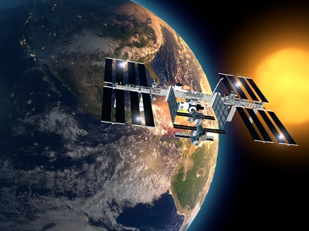 International Space Station in orbit around the earth Stock Photo
