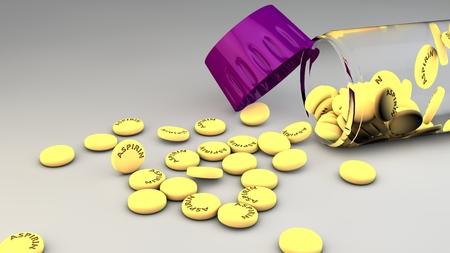 aspirin: Spilled aspirin pills and bottle on gray background