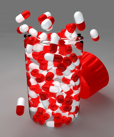aching: Spilled red pills and bottle on gray background