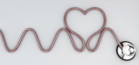Estetoscopio, instrumento auscultación cardíaca. Estetoscopio descansando en un avión, en forma de corazón
