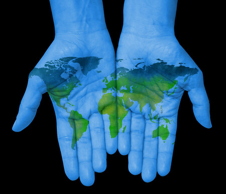Hands with world map, map of the world drawn
