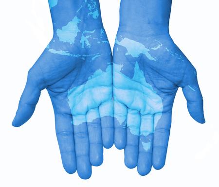 el mundo en tus manos: Manos con Australia e Indonesia, Australia mapa dibujado. El mundo en sus manos