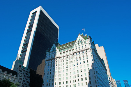 The Plaza hotel, historical building in New York City skyline, flags, architecture
