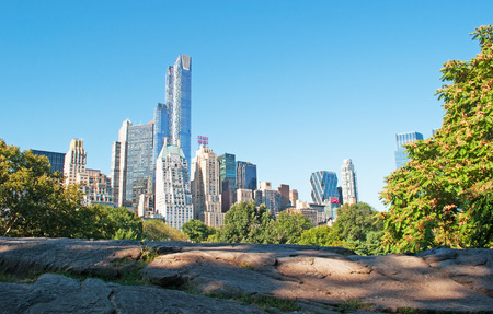 city park skyline: Rocks and buildings overview from Central Park, skyline, skyscrapers, New York City Editorial