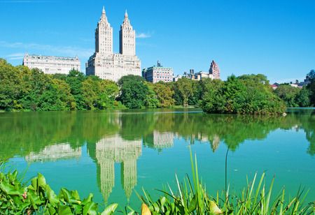 bowery: San Remo building reflected in a pond, Central Park, New York City