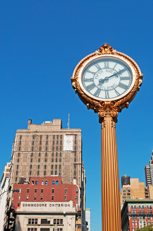 bowery: Fifth Avenue Clock in Times Square, New York City skyline