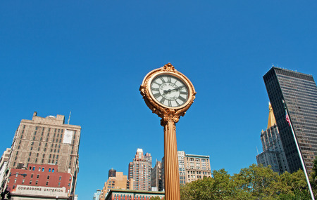 upper floor: Fifth Avenue Clock in Times Square, New York City skyline