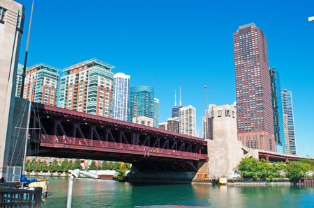 magnificent mile: Panoramic view on Chicago river, buildings and skyscrapers, waterway, movable bridge and canal cruising