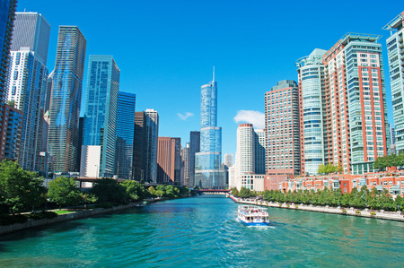 Panoramic view on Chicago river, Trump Tower, buildings and skyscrapers, waterway, movable bridge and canal cruising Editorial