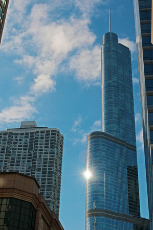 magnificent mile: Chicago skyline with sun reflection on the Trump Tower