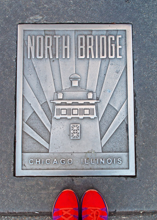 magnificent mile: North Bridge plate on the street with orange shoes, Chicago