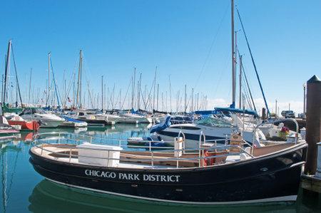 speedboats: Sailboats and speedboats, dock, Chicago, Lake Michigan shoreline