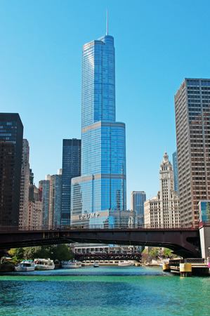 movable bridge: Chicago: looking up at Trump Tower and Wrigley Building from a canal cruise on the Chicago River on September 22, 2014