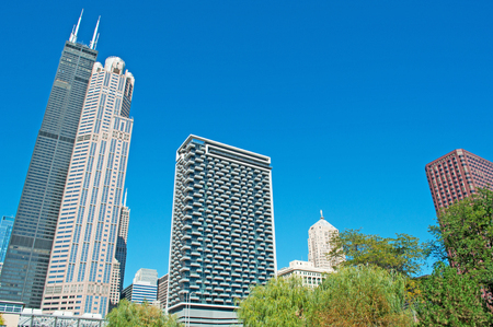 willis: Chicago: looking up at the skyline and Willis Tower from canal cruise on the Chicago River on September 22, 2014