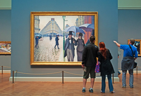 Looking at oil painting Paris Street Rainy Day by Gustave Caillebotte, Art Institute of Chicago Stok Fotoğraf