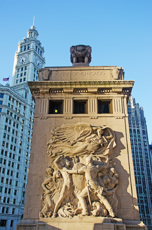 michigan avenue: Chicago: City inscription on Michigan Avenue Bridge and Wrigley Building on September 22, 2014 Editorial