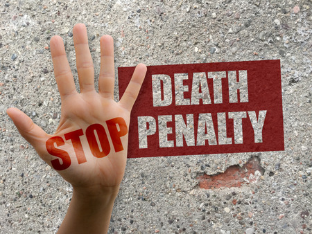 abolition: Stop the death penalty, open hand, wall with graffiti