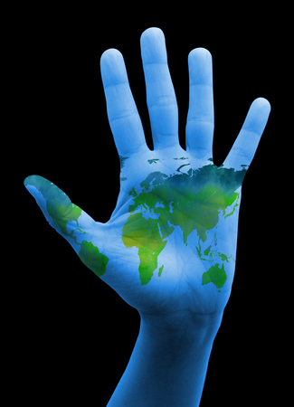 guerrilla warfare: Hand with map of the world. The world in your hand
