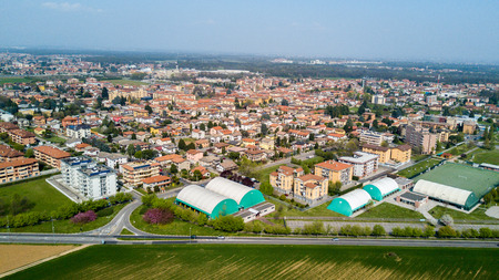 Nature and landscape, municipality of Solaro, Milano: Aerial view of a field, houses and homes, farming, grass green, countryside, farming, trees. italy