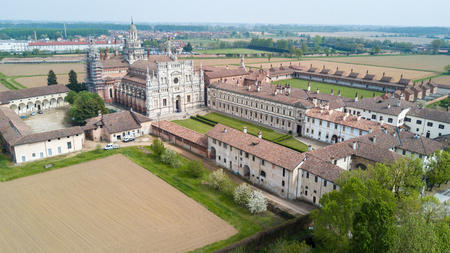 Aerial view of the Certosa di Pavia, built in the late fourteenth century, courts and the cloister of the monastery and shrine in the province of Pavia, Lombardia, Italy.