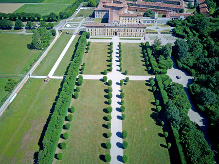 show window: Villa Arconati, Castellazzo, Bollate, Milan, Italy. Aerial view of Villa Arconati 17062017. Gardens and park, Groane Park. Palace, baroque style palace, streets and trees seen from above Editorial