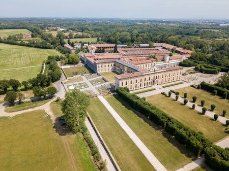 show window: Villa Arconati, Castellazzo, Bollate, Milan, Italy. Aerial view of Villa Arconati 21062017. Gardens and park, Groane Park. Palace, baroque style palace, streets and trees seen from above