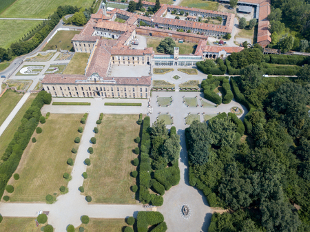 manifestations: Villa Arconati, Castellazzo, Bollate, Milan, Italy. Aerial view of Villa Arconati 21062017. Gardens and park, Groane Park. Palace, baroque style palace, streets and trees seen from above