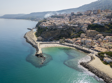 dwelling: Aerial view of Pizzo Calabro, pier, castle, Calabria, tourism Italy. Panoramic view of the small town of Pizzo Calabro by the sea. Houses on the rock. On the cliff stands the Aragonese castle