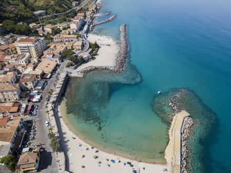 nuances: Aerial view of a pier with rocks and rocks on the sea. Pier of Pizzo Calabro, panoramic view from above. Summer sea and tourism on the Calabrian coast of Southern Italy. Calabria, Italy